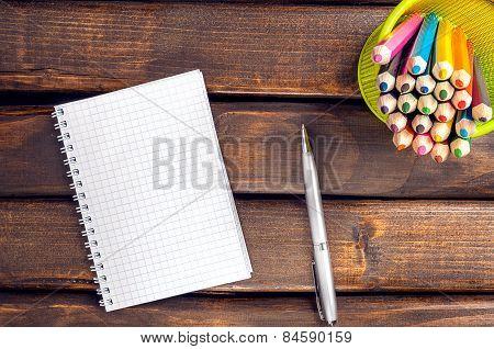 Notepad, pen, pencil.