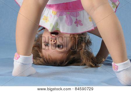 Cute Little Girl Upside Down
