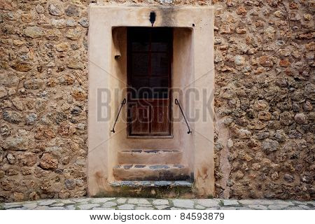 traditional old door and wall in the historic village Deia in Majorca