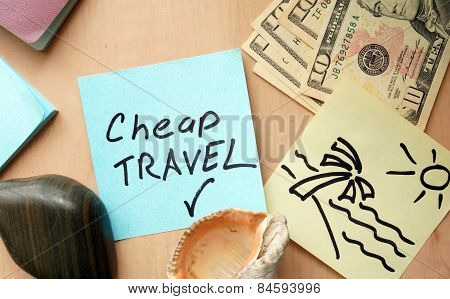 Cheap travel paper on a table with money.
