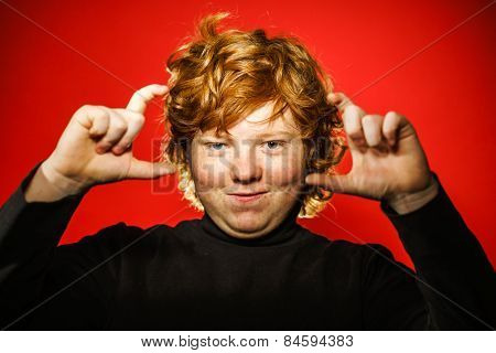 Expressive Red-haired Teenage Boy Showing Emotions In Studio