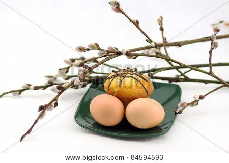 eggs and cake on a plate and willow