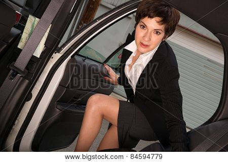 Attractive Determined Business Woman Traveler Enters Taxi Cab