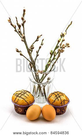 eggs, cupcakes  and willow on a white background