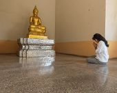 picture of glorify  - Thai woman pay homage to Buddha statue, Buddhist respect