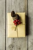 pic of embellish  - Gifts wrapped in kraft paper tied with twine and embellished with natural details - JPG