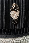 stock photo of brooch  - seahorse brooch on black silk background with diamonds - JPG
