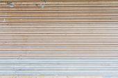 foto of roller shutter door  - old metal roller shutter texture for background - JPG