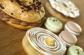 """foto of brest  - Cake """"Paris-Brest"""" macaroons and lemon pies on a table ** Note: Shallow depth of field - JPG"""