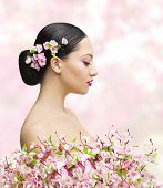 pic of japan girl  - Woman Beauty Portrait in Sakura Flower Asian Girl Bun Hairstyle Beautiful Model Over Pink Background - JPG