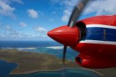 picture of falklands  - Aircraft flying over beautiful white sandy beaches and clear blue waters of the Falkland Islands in the South Atlantic - JPG