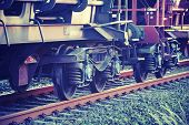 stock photo of train-wheel  - wheels of a train on the tracks vintage style - JPG