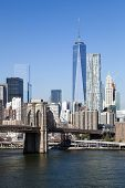 stock photo of freedom tower  - The New York City skyline at afternoon w the Freedom tower and Brooklyn bridge - JPG