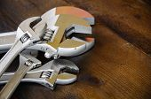 image of adjustable-spanner  - Spanner or adjustable wrench on wooden back ground - JPG