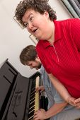 stock photo of disability  - Mentally disabled woman singing in a music therapy - JPG