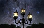 image of lamp post  - Vintage looking lamp post against beautiful starry sky - JPG