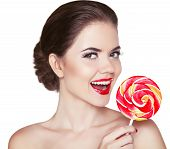 picture of lollipop  - Attractive cheerful Woman with red lips makeup is smiling holding colorful lollipop isolated on white background - JPG