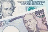 pic of currency  - Japanese yen currency and dollar bank note use for currency concept - JPG