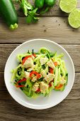 stock photo of zucchini  - Healthy zucchini noodle dish with chicken on wood background overhead view - JPG