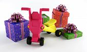 stock photo of tricycle  - Tricycle with a gift box on a white background - JPG