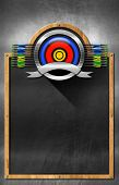 pic of fletching  - Empty blackboard with wooden frame and metallic archery symbol - JPG