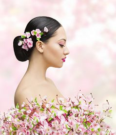 picture of japan girl  - Woman Beauty Portrait in Sakura Flower Asian Girl Bun Hairstyle Beautiful Model Over Pink Background - JPG