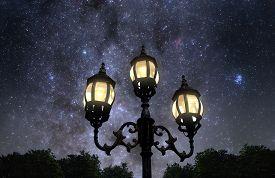 pic of lamp post  - Vintage looking lamp post against beautiful starry sky - JPG