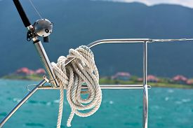 pic of rod  - A rope tied around a lifeline and a fishing rod on a yacht - JPG