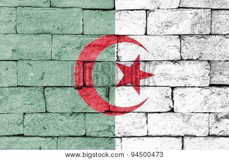 Flag Of Algeria On Old Brick Wall.