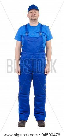 Man in blue overalls.