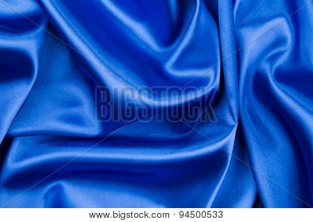 Silk cloth with folds of dark blue texture.