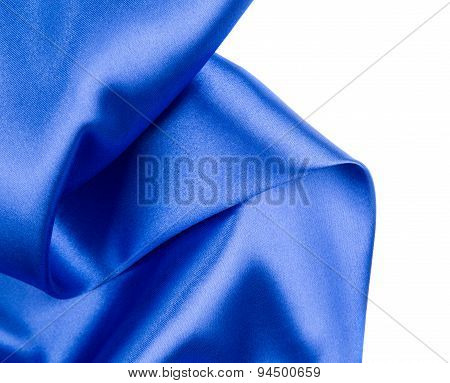 Silk cloth with folds of dark blue.