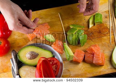 Chef Is Implating Salmon Filett On A Skewer