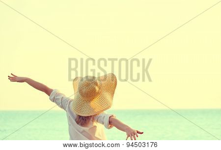Happy Woman In Hat Is Back  Opened His Hands, Enjoys Sunset