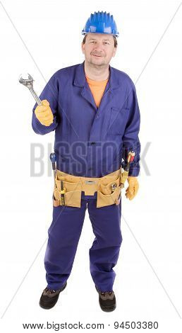 Worker in hard hat holding wrench.