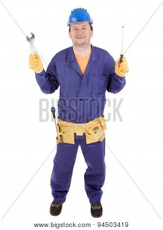 Worker in hard hat holding wrench and screwdriver.