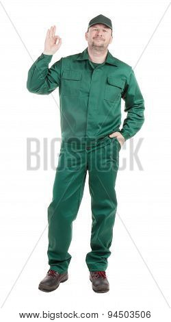 Worker in green with ok sign.