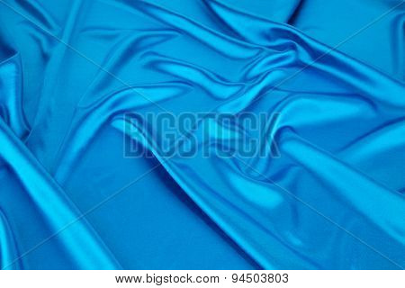 Silk cloth with folds of deep blue texture.