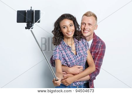 Happy couple making photos