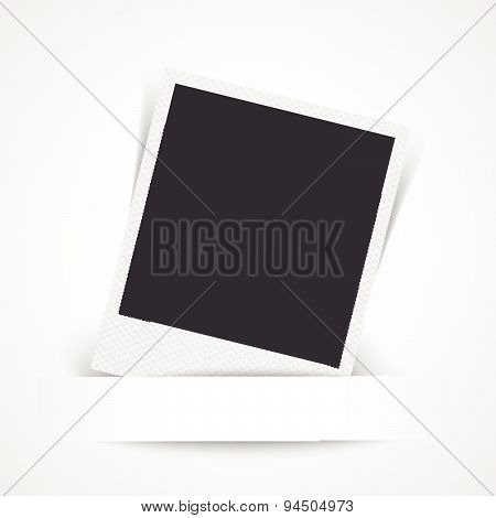 Blank photo frame on white wall