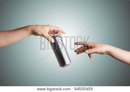 Male hand giving a beer can to another person