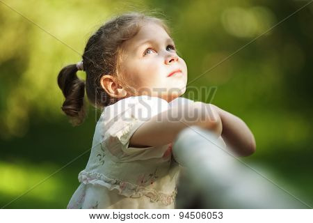 Little Happy Beautiful Girl Looking Up