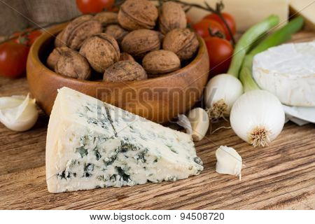 Portion Of Niva Danish Blue Cheese Next To Various Vegetable