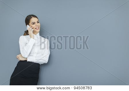 Young Woman By The Wall
