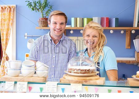 Portrait Of Couple Running Cafe Together