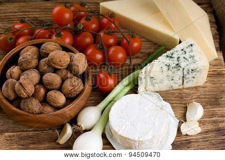 Three Kinds Of Cheese And Several Kinds Of Vegetable
