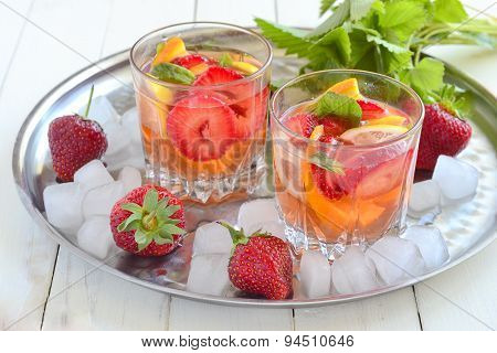 Refreshing summer drink with strawberries and citrus