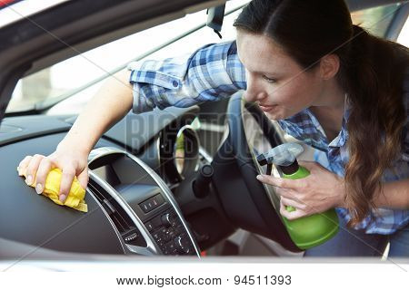 Woman Cleaning Interior Of Car
