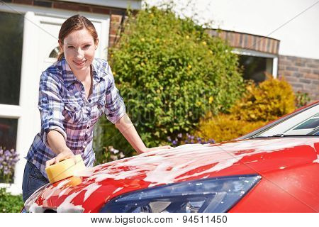 Portrait Of Woman Washing Car
