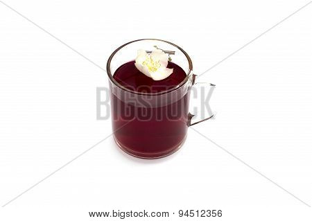 The Transparent Mug Of Red Drink Decorated With A Flower,